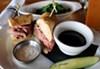 The French dip sandwich served with Horseradish cream and a side of sauteed greens.