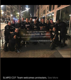 St. Louis riot police pose after kettling protesters in a photo posted to social media and later included in court filings.