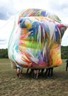 Claire Ashley,<i>Ruddy Udder Dance</i>, 2017. Spray paint, PVC coated canvas tarpaulin, rope, dancers, 2 x 12 x 22 feet. Courtesy of the artist, Chicago