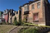Both vacant homes damaged on Monday are owned by Green Line LLC.