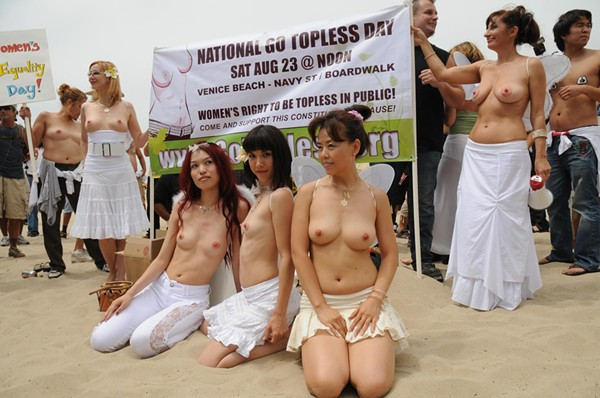 Better, Topless women in public apologise, but