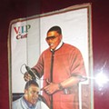 Photo of the Day: Nelly Gives Obama a Haircut in Bogota, Colombia Bar