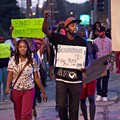 Ferguson Protesters to Police: Shooter Was Not One of Us