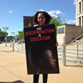 Barred from Their St. Louis School Because They're Black, a Family Files Suit