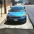 Kingshighway Workers Pave Around Single Parked Car, Because St. Louis