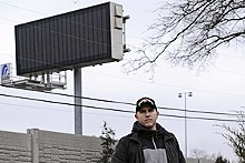 JENNIFER SILVERBERG - Mark Alexander, in his Frontenac back yard, with its new sound wall and traffic board.