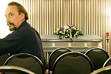 JENNIFER SILVERBERG - Jeff Palmore in the chapel of Bell Funeral Home. The casket is empty.