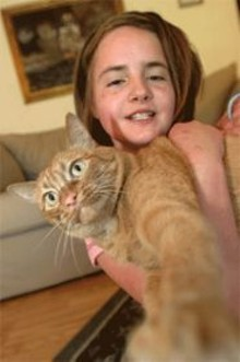 JENNIFER  SILVERBERG - Eleven-year-old Anastasia McGrath loves her easygoing cat, Tiger.