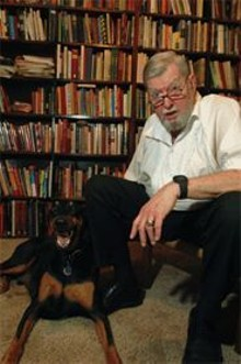 JENNIFER  SILVERBERG - Two wily dogs: Ex-bartender Mark Pollman and his Doberman, Harry.