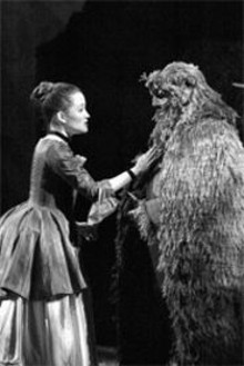 CORY  WEAVER - Anna Christy and John Osborn are part of a beautiful - Beast with a magical kingdom as their - backdrop.