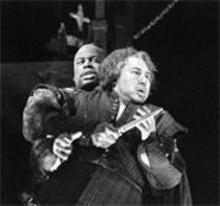 KEN  HOWARD - Morris Robinson as Sparafucile and Chen-Ye Yuan as - the title character get to the point in Verdi's  - Rigoletto.