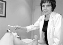 JENNIFER  SILVERBERG - Wax on: Rina Tesler, an aesthetician at The Face & The Body, prepares to work her magic.
