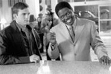 Fatherly advice: Bernie Mac (right) tells Ashton - Kutcher (left) a thing or two.