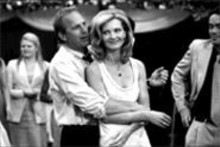 Message in a bottle: Kevin Costner (left) and Joan - Allen (right) find out there's more to life than a late- - morning cocktail.