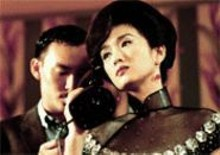 "The tailor and the courtesan: Chang Chen (left) and Gong Li (right) in ""The Hand."""