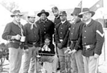 The Buffalo Soldiers enjoy cups of coffee while waiting - for the Buffalo Gals to come out tonight.