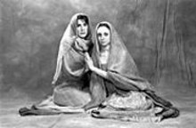 WUSTL PHOTO SERVICES - Ladies in waiting: Ann Marie Mohr (right) as - Andromache and Lindsay Brill (left) as Hecuba in - The Trojan Women.