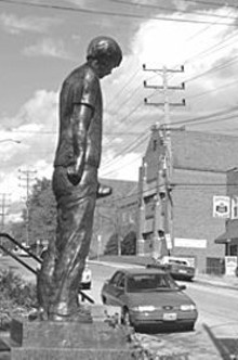 ERIC  FOGLEMAN - Children from nearby St. James the Greater parish school are taking great pleasure in alerting residents to the statue's special feature.