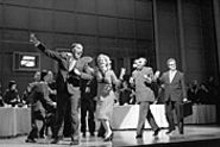 KEN  HOWARD - Revolutionary theater: (left to right) Robert Orth as - Richard Nixon, Maria Kanyova as Pat Nixon, Chen-Ye - Yuan as Zhou Enlai and Jan Opalach as Henry - Kissinger.