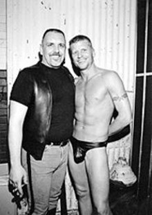 SCOTT  LOKITZ - Newly tanned Mr. Missouri Leather Ron Walters (right) - hopes outgoing champ Mark Bozif keeps that lighted - stogie away from the ol' rawhide.