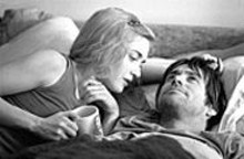 Don't I know you? Kate Winslet ponders Jim Carrey's - Spotless Mind.