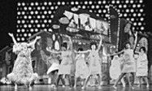 PAUL  KOLNIK - High-tech glitz without crude garishness: Bruce - Vilanch (at left) and the cast of Hairspray