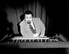 CARLOS  TALLARICO - We have no problem believing that this man's name is - Joey DeFrancesco.