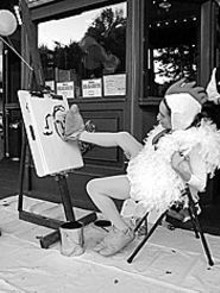 The Circus Chicken, a.k.a. Karen Woodward, draws portraits for chicken feed as part of Loop in Motion