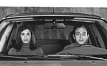 Manal Khader and Elia Suleiman in Divine Intervention