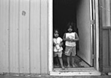 """JENNIFER  SILVERBERG - Jennifer Silverberg's """"Sisters at Migrant Camp. Missouri Bootheel"""" is on view at the Bonsack Gallery."""