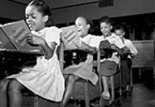 ST. LOUIS PUBLIC SCHOOL ARCHIVES - Children singing at the Simmons School in 1945, part of Through the Eyes of a Child: Growing Up Black in St. Louis, 1940-1990, on view at the Missouri History Museum.