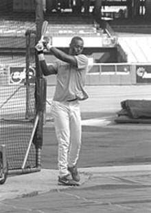 JENNIFER  SILVERBERG - Edgar Renteria warms up October 10 before the Cardinals' final home playoff game. Former Redbird GM Bing Devine says he considers Renteria the best shortstop in the National League.