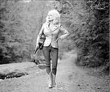 ANNIE  LEIBOVITZ - Dolly Parton walks it straight and narrow.