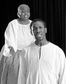 SOUTHERN ILLINOIS UNIVERSITY-EDWARDSVILLE - Erica C. Sutherlin and Joel P.E. King in Slave Coffle With Observer, one of nine one-act plays in Rowing to America