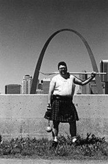 Joe Moore with 28-pound weight, pitchfork, kilt and Arch