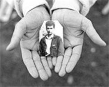 TOM  MADAY - One of the two images visitors to the Missouri Historical Society will be presented with: Muska Oric's hands holding a photograph of her husband, Haso, missing since Srebrenica's fall in 1995.