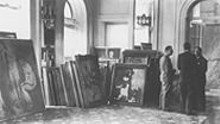 "Matisse's ""Bathers with a Turtle"" was stacked against other canvases at the Grand Hotel Nationale in Lucerne, Switzerland, before its sale at the degenerate-art auction in 1939. The photo suggests the reality behind what is now a tabloid phrase -- ""the Nazi shadow."""