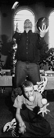 JENNIFER  SILVERBERG - Richard Kennison and his son, Book, juggle at Hope Presbyterian Church.