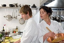 DAVID LEE - Aaron Eckhart and Catherine Zeta-Jones cook up something sweet in Reservations.