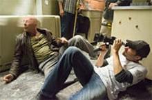 Director Len Wiseman frames Bruce Willis in Live Free or Die Hard.