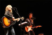 From way out West: Lucinda Williams and Doug Pettibone get the show on the road.