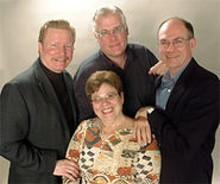 On with the shows: Steve Isom (left), Doug Finlayson - (center), Rob Townsend (right) and Kathleen Sitzer (seated).