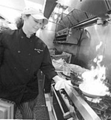 JENNIFER  SILVERBERG - Chef Sharon Govreau heats things up at the Lynch Street Bistro.