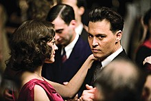 On target: John Dillinger (Johnny Depp) romances Billie Frechette (Marion Cotillard) between robbing banks.