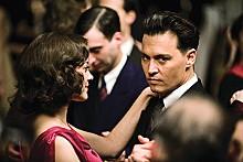 On target: John Dillinger (Johnny Depp) romances Billie Frechette (Marion Cotillard) between robbing banks.