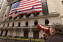 Michael Moore wags his finger at Wall Street.