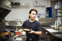 JENNIFER SILVERBERG - Chef Tony Truong at work in Pearl Café's kitchen in Florissant.