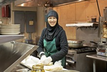 JENNIFER SILVERBERG - Roudayna Mohsen prepares a sandwich in the kitchen of the Vine.