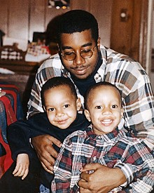 COURTESY THEDA THOMAS - Christian Ferguson (left) and his younger brother, Connor (right), with their father, Dawan Ferguson, in a photo from the mid-1990s. The boys were born a year apart; Christian had citrullinemia but Connor did not.