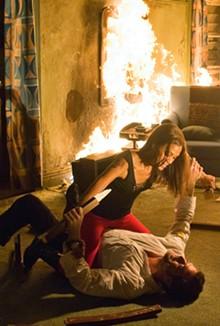 JOHN BRAMLEY - Not so hot: Zoe Saldana (Aisha) and Jeffrey Dean Morgan (Clay) are lukewarm in Losers.